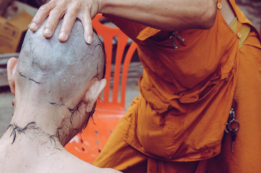 The ceremony of shaving the hair, Buddhist Ordination Hair Ordination Religion And Tradition Thai Thailand Tradition Traditional Culture Buddhist Culture Buddhist Monks Ceremony Close-up Hand Human Body Part Human Hand Men Monk  Ordination Ceremony Religion Religion And Beliefs Shaving Traditional