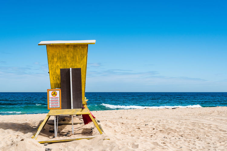 Scenic view of yellow lifeguard hut against sea and blue sky during sunny day Atlantic Canary Islands Fuerteventura Nature Beach Beauty In Nature Blue Blue Sky Corralejo Day Horizon Horizon Over Water Land Lifeguard Hut Nature No People Ocean Outdoors Protection Safety Sand Scenics - Nature Sea Seascape Security Sky Tranquil Scene Tranquility Water
