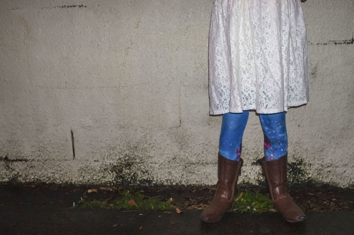 Low section of a girl wearing boots, blue tights with stars and a white lace dress, against a wall at night. Boots Girl Power Casual Clothing Girl Girl In Boots Girlhood Lifestyles Low Section One Person Real People Standing Visual Creativity The Fashion Photographer - 2018 EyeEm Awards