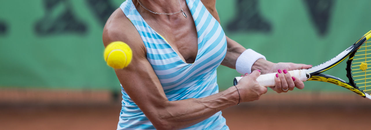 tennis player Holding Sport Midsection One Person Focus On Foreground Tennis Exercising Healthy Lifestyle Lifestyles Day Hand Standing Adult Real People Human Hand Human Body Part Tennis Racket Men Leisure Activity Outdoors