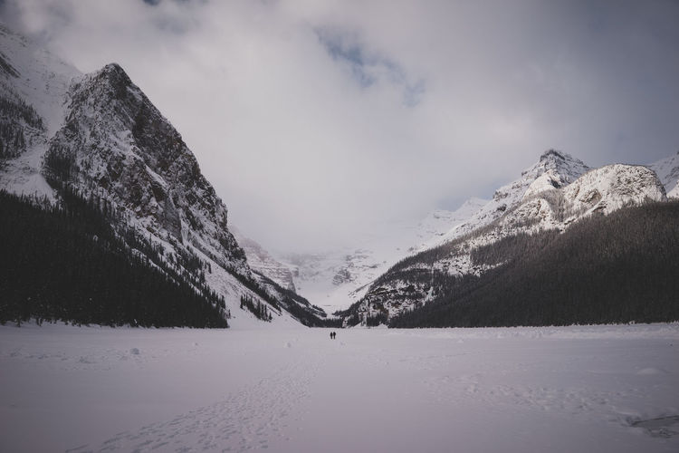 Lake Louise in the mornig Lake Louise,Alberta Snow ❄ Beauty In Nature Cloud - Sky Cold Temperature Day Landscape Live Authentic Mountain Mountain Range Nature No People Outdoors Scenics Sky Snow Snowcapped Mountain Tranquil Scene Tranquility Travel Destinations Vacations Wide Winter