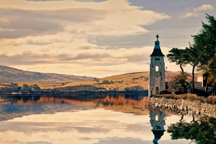 Portmeirion, North Wales, UK Built Structure Sky Water Reflection Building Exterior Building Architecture Cloud - Sky Mountain Waterfront Nature Place Of Worship Lake Tower Religion No People Belief Outdoors Spire