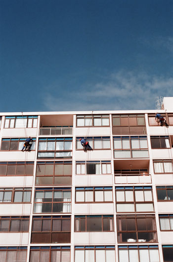 35mm Analogue Photography Cape Town Clear Sky Architecture Blue Sky Building Building Exterior Built Structure City Cleaning Day Hanging Low Angle View Men Outdoors People Sky Window Window Washer Working