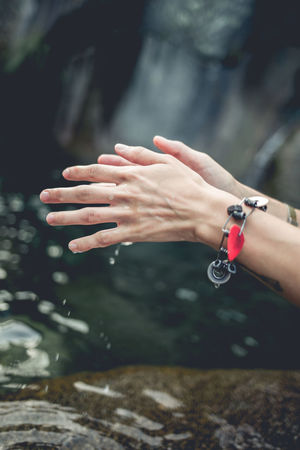 Woman hands playing with water on the river Gredos Playing With Water Riverside Close-up Focus On Foreground Hands With Water Human Finger Human Hand Mountain Outdoors People River Riverscape Riverside Photography Rocks Water Women
