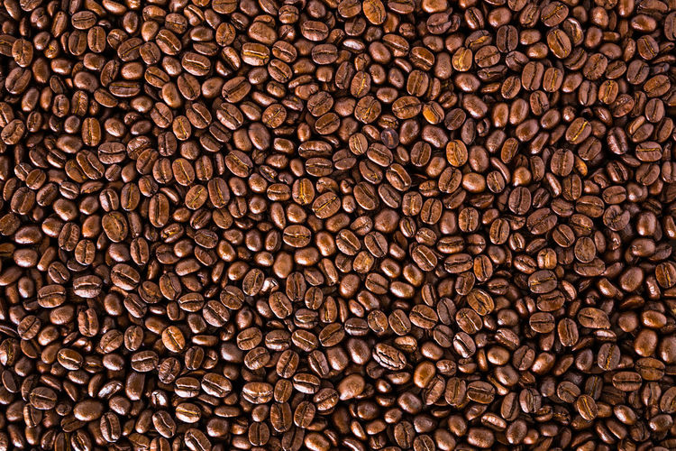 Roasted coffee beans For use as background Aroma Drink Morning Pattern Seed Space Wallpaper Backgrounds Beans Of Coffee Brown Cafe Close-up Energy Food Food And Drink Freshness Full Frame Gourmet Food Heap Large Group Of Objects Roasted Roasted Coffee Bean Stack Textured  Textured Effect