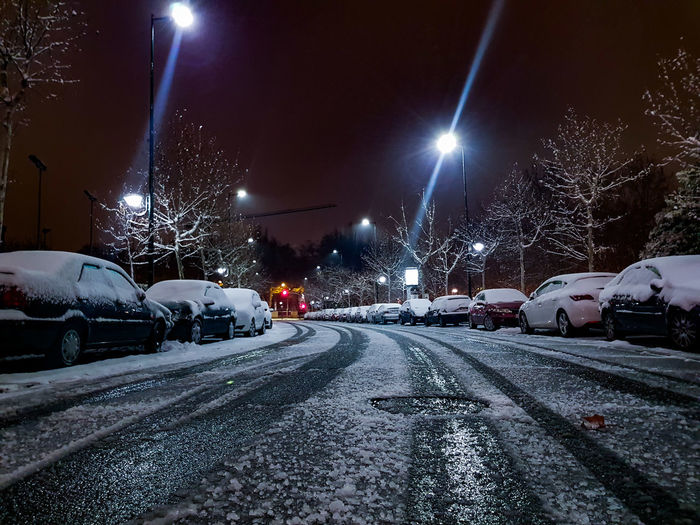 Cars on road in winter at night