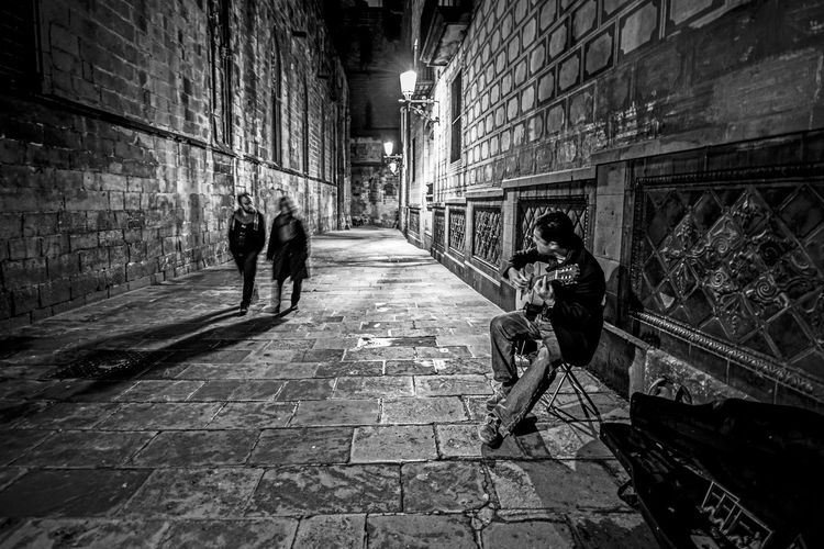 """""""The Street Musician"""" Architecture Brick Wall Building Exterior Built Structure City Men Outdoors People Real People Two People The Street Photographer - 2017 EyeEm Awards EyeEm Selects Stories From The City The Street Photographer - 2018 EyeEm Awards The Art Of Street Photography My Best Photo"""