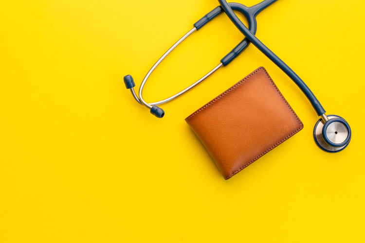 High angle view of electric lamp against yellow background