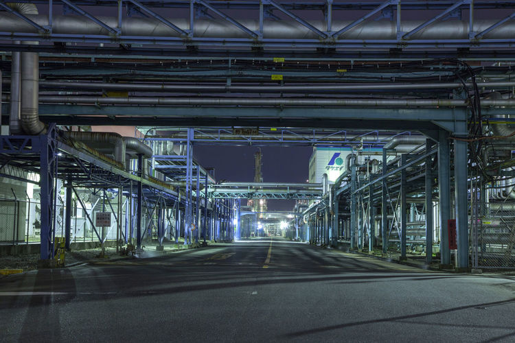 factory in japan Architectural Column Architecture Bridge Bridge - Man Made Structure Building Exterior Built Structure Ceiling City Connection Direction Empty Illuminated Lighting Equipment Night No People Outdoors Road Road Marking Sign Street The Way Forward Transportation