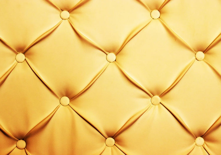 Full Frame Image Of Gold Chesterfield Sofa