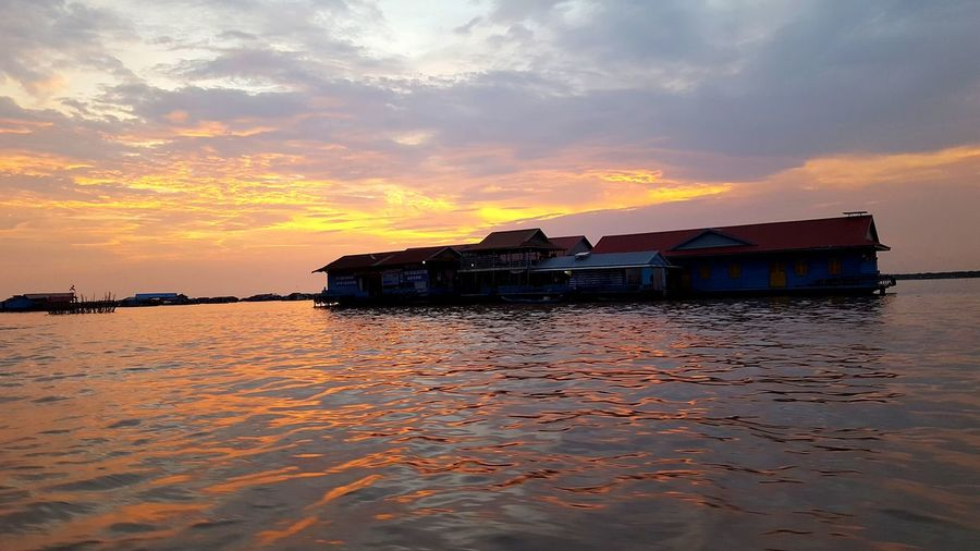 Floating houses Floatinghousese Houseonwater Amazing Cambodgia Water Nautical Vessel Sea Sunset Stilt House Reflection Sky Architecture Building Exterior Built Structure Boathouse