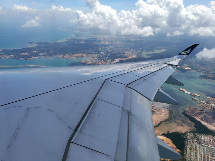 reflecting the blue sky on the wing! Discover Your City Cathay Pacific EyeEm Gallery ASIA Eyeem Travel Wanderlust Wanderer On Board Inflight Sky And Clouds Tourist Attraction  Eyeem Singapore Traveling In The Sky Leica Lens Travel Destinations Blue Sky Airplane Water Flying Sea Airplane Wing Air Vehicle Aerial View Aircraft Wing Mid-air Sky Aeroplane Airways Flight