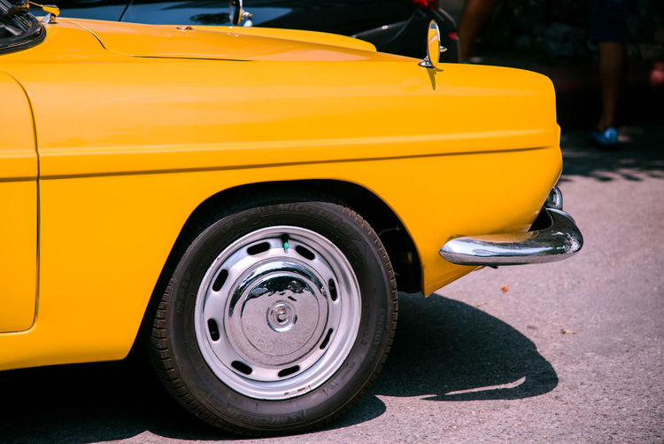 Close up yellow retro classic car Classic Retro Wheel Car City Close-up Day Focus On Foreground Land Vehicle Mode Of Transportation Motor Vehicle No People Outdoors Parking Retro Styled Road Street Tire Transportation Vintage Wheel Yellow