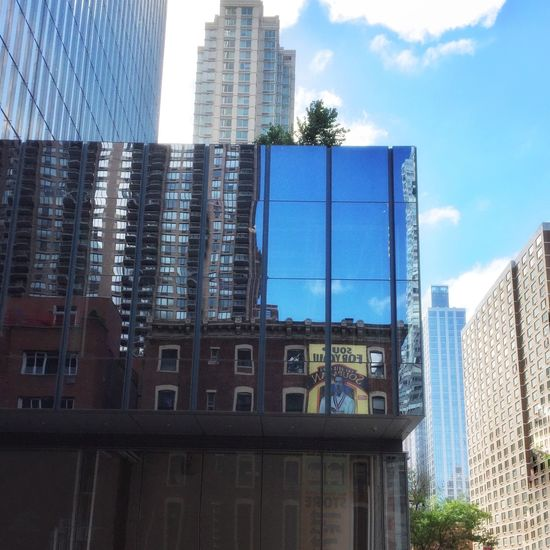 Looking at you, looking at me: buildings, architecture and reflections. NYC theater district off 8th Avenue Iphonephotoacademy Reflection NYC Photography Iphone6 Streetphotography Iphonephotography IPS2015Architecture Architecture NYC Buildings IPhoneography Sky IPS2016Blue