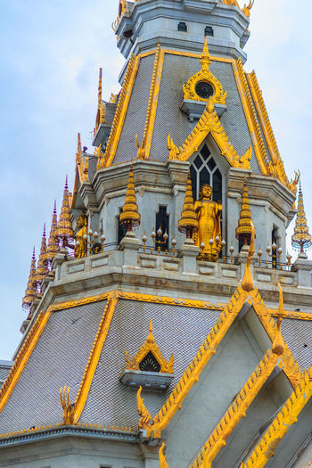 Beautiful Thai's style craving and decoration on the golden gable end at Wat Sothonwararam, a famous public temple in Chachoengsao Province, Thailand. Buddhism Temple Chachoengsao Chachoengsao Province Cloudy Day Cloudy Sky Dramatic Sky Gable End Golden Temple Thai's Style WAT Sothon Wara RAM Worawihan (WAT Luang PHO Sothon) Wat Sothon Wat Sothon Wararam Worawihan Buddhist Temple Cloudy Sunset Cloudysky Dramatic Landscape Dramatic Skies Gable Gable Roof Gable Temple Naga Gables Golden Gable Pagoda Temple Wat Sothonwararam White Clouds And Blue Sky