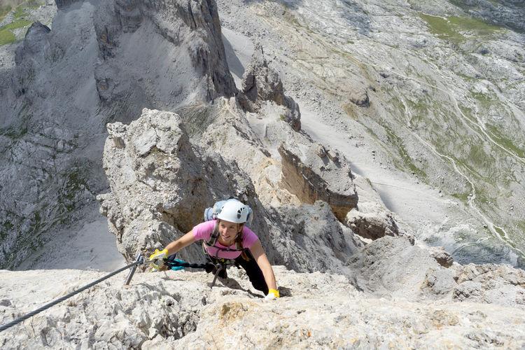 High angle view of woman climbing mountain