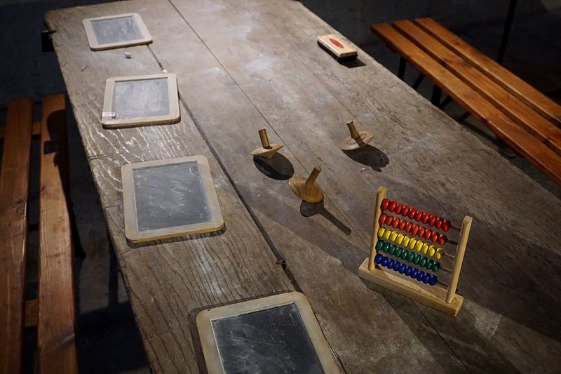 Abacus calculator and slate on table