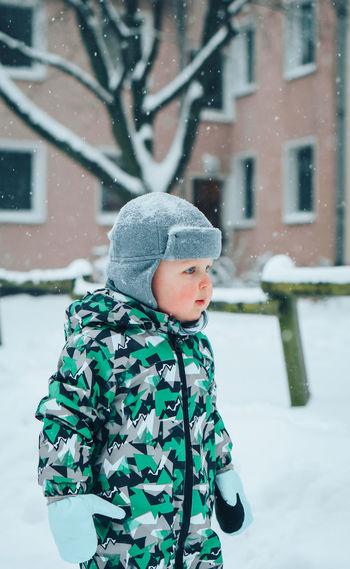 Cute boy standing in snow