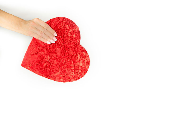 Woman is holding a heart shaped gift box Gift Box Gift Heart Heart Shaped  Love Copy Space Hand Female Hand Caucasian Valentine's Day  Banner Backgrounds Background Romance Emotion Human Body Part Red Human Hand Studio Shot One Person White Background Indoors  Close-up Holding Body Part Food And Drink Heart Shape High Angle View Women Human Finger Finger Freshness Human Limb