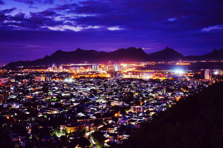 View on Ebene and Moka Mountain Range Mauritius Night Illuminated Cityscape Mountain Crowded Outdoors Sky High Angle View City Building Exterior Architecture Nightlife Lightning Nature People Nightphotography Night Lights