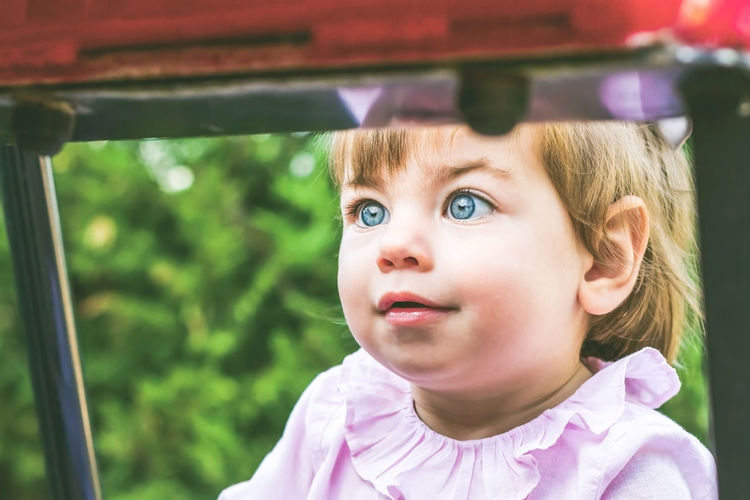 Childhood Child Portrait Headshot Girls One Person Close-up Mode Of Transportation Females Blond Hair Innocence Car Offspring Front View Cute Real People Looking At Camera Hair Outdoors Human Face Contemplation Dream Learning Parenting