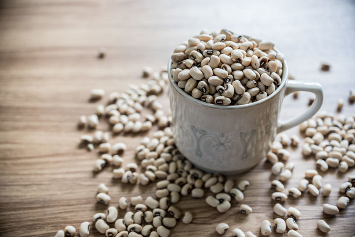 Bean Cereal Plant Close-up Day Dry Food Food And Drink Freshness Healthy Eating Indoors  Ingredient Legume Family No People Raw Food Seed Selective Focus Still Life Table Wheat Wood - Material