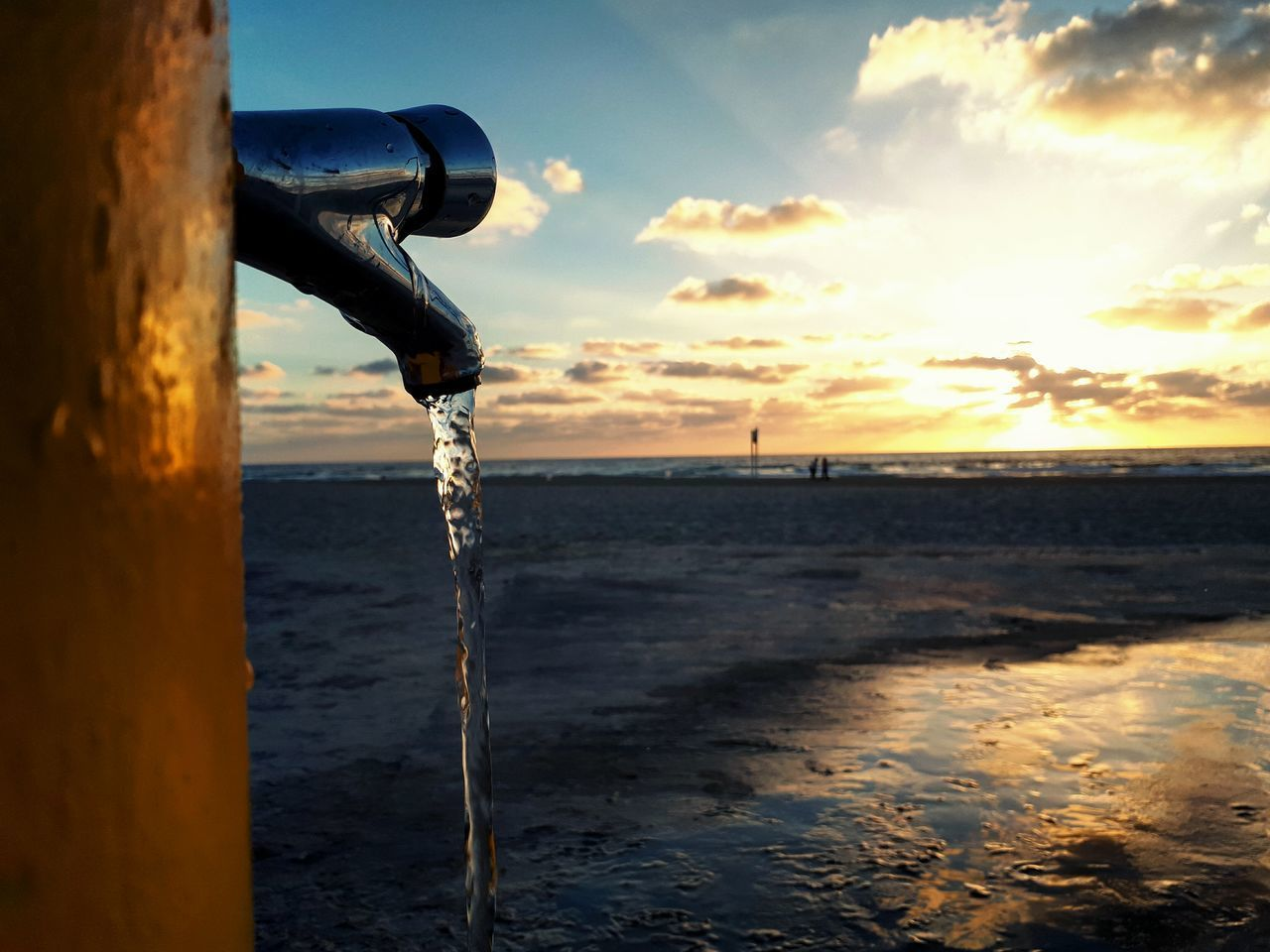 water, nature, sunset, sea, outdoors, sky, beauty in nature, no people, scenics, tranquility, motion, beach, cold temperature, day, close-up, dripping