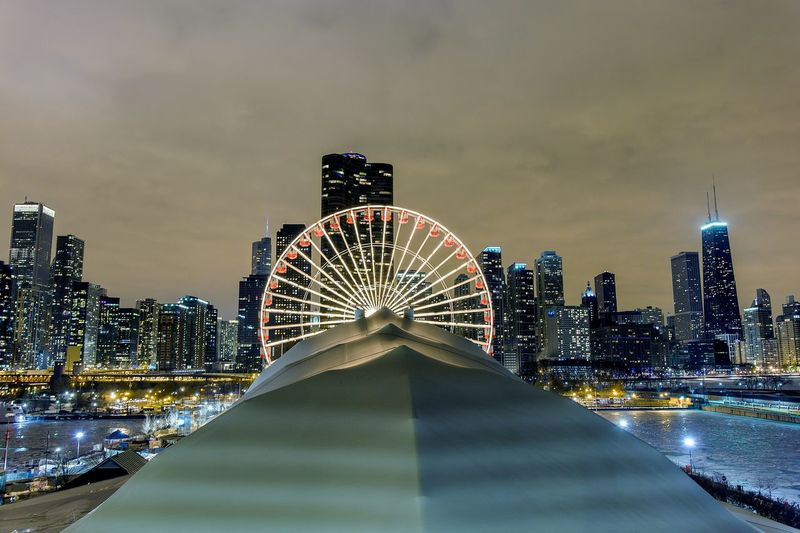 Illuminated Ferris Wheel Against Skyline At Navy Pier