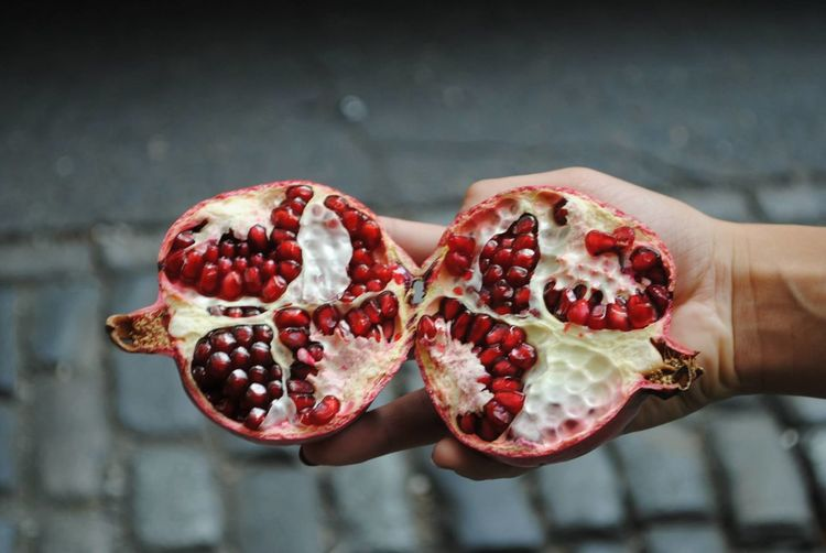 Close-up of hand holding pomegranate