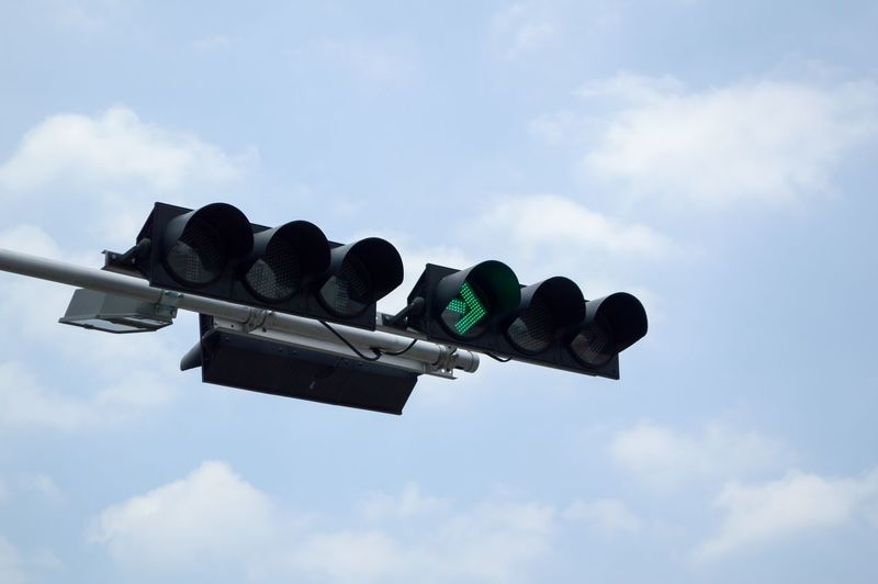 Lighting Equipment Transportation Car Cloud - Sky Communication Day Direction Green Light Guidance Lamp Light Lighting Equipment Low Angle View Nature No People Outdoors Road Sign Road Signal Safety Sign Signal Sky Stoplight Symbol
