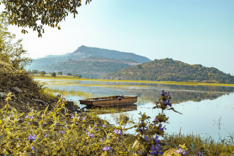 panshet lake Panshet Landscape Boat Water Nature Adult Agriculture Reflection Beauty In Nature One Person Lake People Mountain Field Outdoors Occupation Farmer Real People Plant