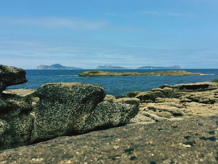 Rocks By Sea At Cies Islands Against Sky