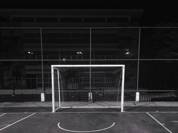 Net on soccer field at night