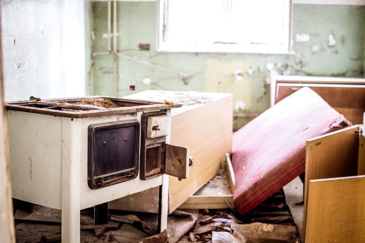 No People Table Indoors  Abandoned Damaged Window Furniture Old Absence Obsolete Day Wood - Material Technology Messy Chair Domestic Room Home Interior Run-down Still Life Dirty Ruined