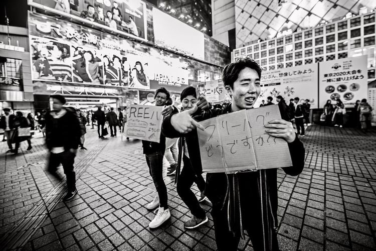"""""""Free Hugs"""" EyeEm Best Edits Blackandwhite EyeEm Best Shots EyeEmNewHere Placard Large Group Of People Banner - Sign Message Portrait Men People Smiling Crowd Outdoors Happiness Building Exterior City Real People Looking At Camera Cheerful Stories From The City #FREIHEITBERLIN The Street Photographer - 2018 EyeEm Awards The Art Of Street Photography My Best Photo"""