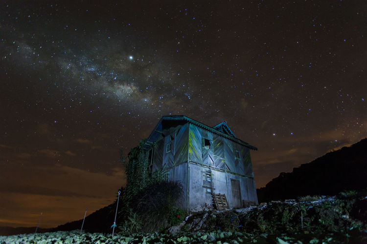 Low angle view of house against sky at night