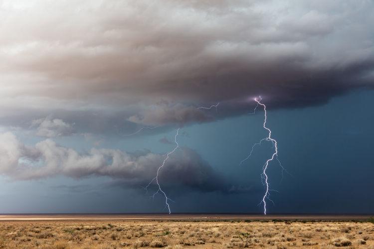 Lightning in sky over land