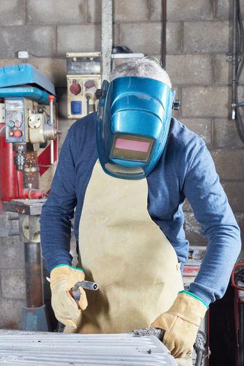 Welder welding in factory