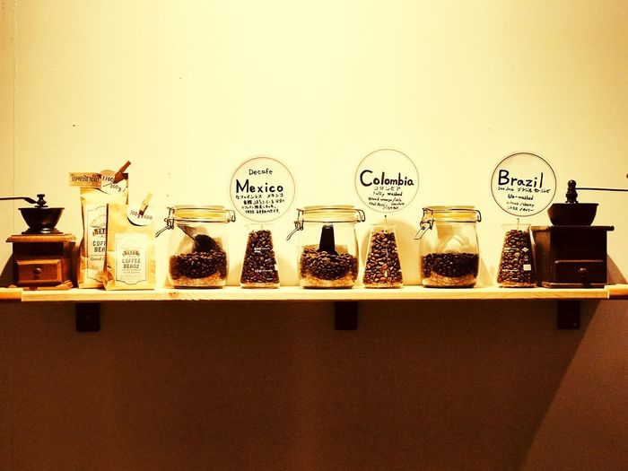 Row of bottles on shelf against wall