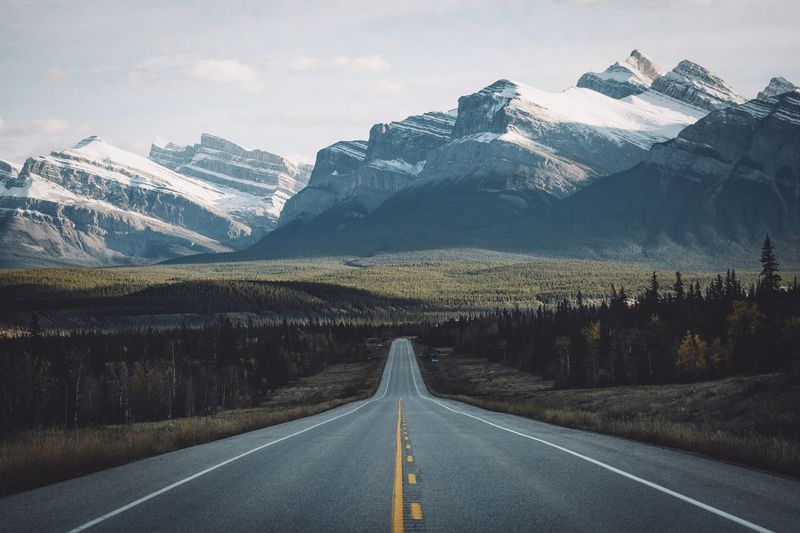 Road less traveled Canada Vscofilm Explore Mountain Mountain Range Road Scenics The Way Forward Beauty In Nature Landscape Day Nature Tranquil Scene Outdoors Sky Snow No People Fresh On Market 2016