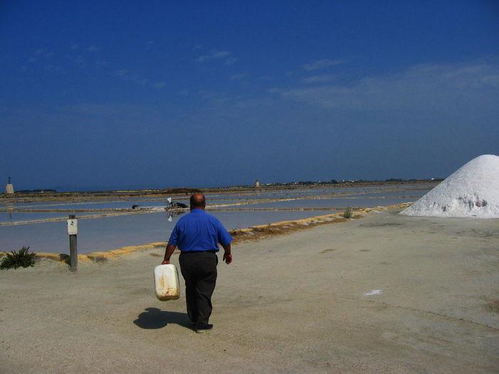 Rear view of man against salt flats
