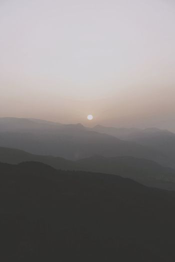 Do you know the difference between being and living? To be is to simply exist. Sky Beauty In Nature Scenics - Nature Tranquility Tranquil Scene Mountain Idyllic Landscape Nature Environment Sunset Sun Silhouette Clear Sky Outdoors Mountain Range Non-urban Scene No People