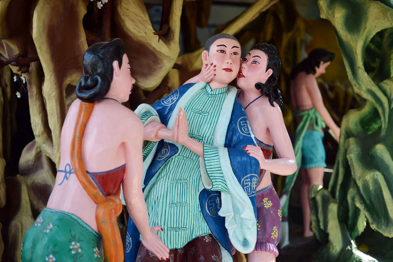 Scenes from Haw Par Villa in Singapore Adult Adults Only Arts Culture And Entertainment Cheerful Chinese Day Fashion Folklore Friendship Happiness Hell Legends Leisure Activity Mythology Outdoors People Singapore Smiling Statue Strange Theme Park Vacations Women Young Adult Young Women