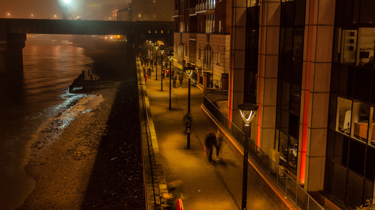 real people, water, night, men, illuminated, built structure, architecture, wet, building exterior, outdoors, women, lifestyles, city, nature, mammal, people