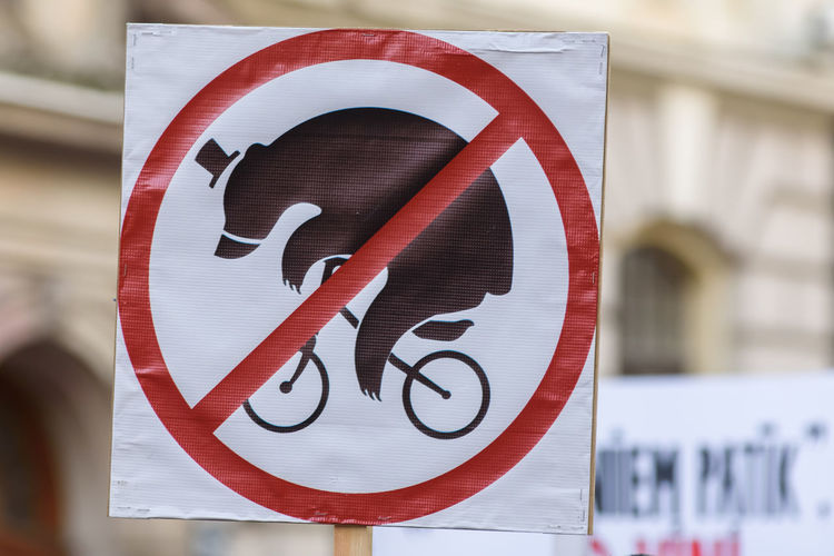 """RIGA, LATVIA - March 30, 2017. Sign """"NO bear on bicycle"""". Protest event against wildlife animal using at Circus, near Parliament of Latvia, in Riga , Latvia. Circus Latvia Photojournalism Protest RigaCity Save Animals Sign Against Animal Cruelty Against Wildlife Animal Using At Circus Animal Animal Themes Care For Animals Communication News No Animals At Circus No Bear On Bicycle No People Reportage Riga Latvia"""
