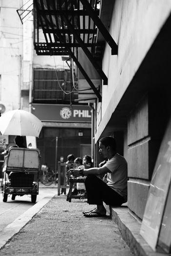 People sitting on street