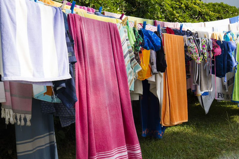 Hanging Clothing Textile Drying Choice Variation Laundry Multi Colored Clothesline Coathanger No People Day In A Row Large Group Of Objects Side By Side Retail  Outdoors Plant Rack Front Or Back Yard Garment