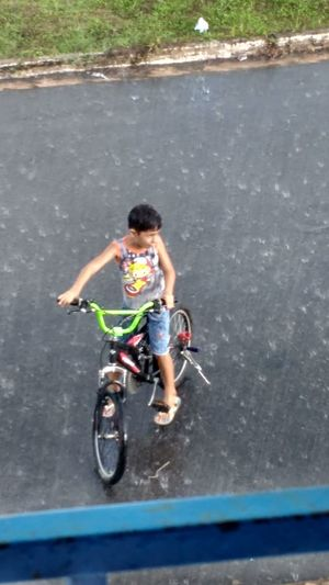 My son taking a shower. Rain Vacations Bike Fun Bicycle People Men Shades Of Winter
