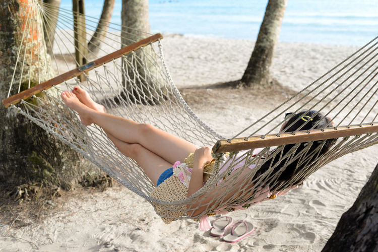 Hammock One Person Beach Leisure Activity Land Nature Relaxation Sand Day Water barefoot Lifestyles Holiday Sea Real People Trip Low Section Vacations Outdoors Cardle Woman Girl Palm Tree Island Travel Holiday Vacations