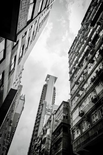 Loneliness Isolation Development Densely Populated Progress Travel Photography Travel Destination Mong Kok Hong Kong Apartment Buildings Modern Living Urban Living Vertical Shot Urbanity Urban Architecture Black & White Photography B & W Photography Black And White Photography Building Exterior Built Structure Architecture Low Angle View Building City Sky Tall - High Skyscraper No People Modern Tower